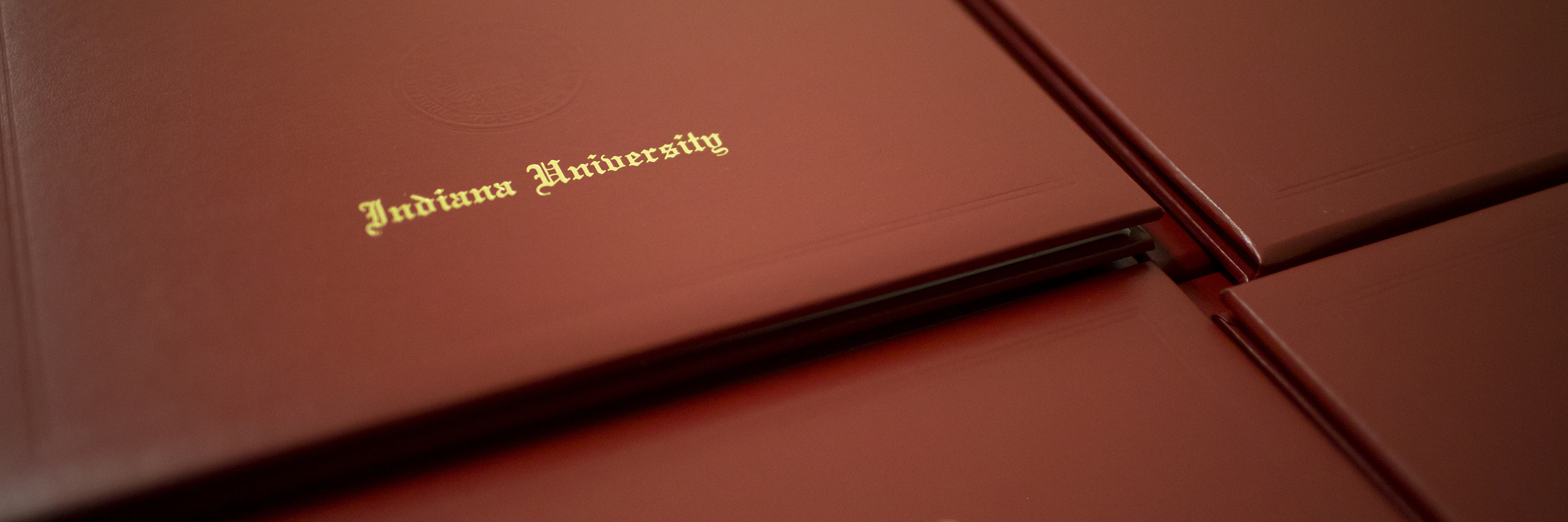 Close-up of Indiana University diploma covers.