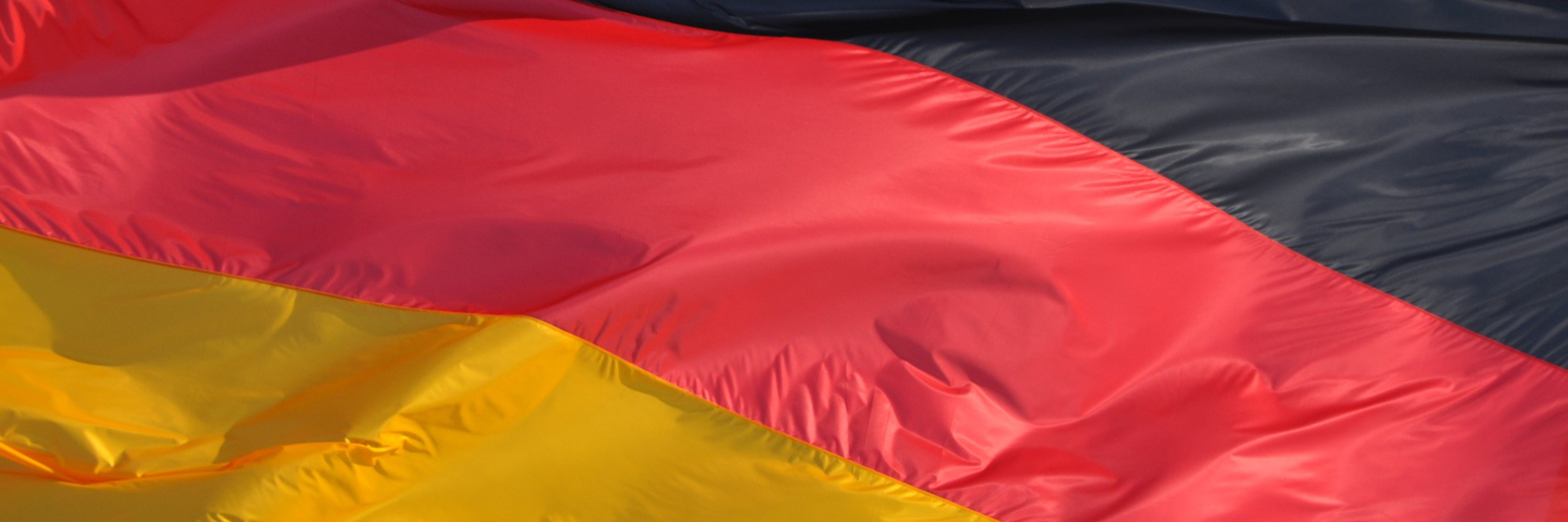 Close-up image of black, red, and yellow German flag.