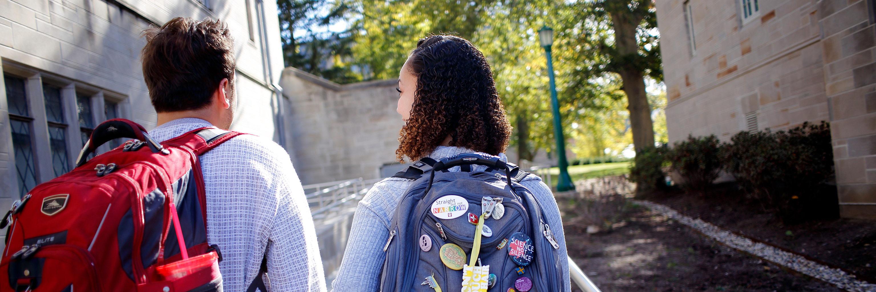 Two students walk through the Indiana University Bloomington campus.
