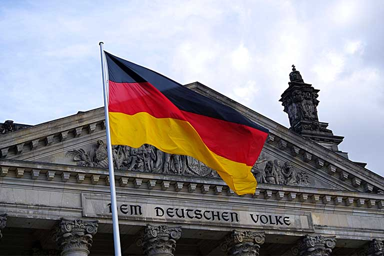 German flag flying in front of building
