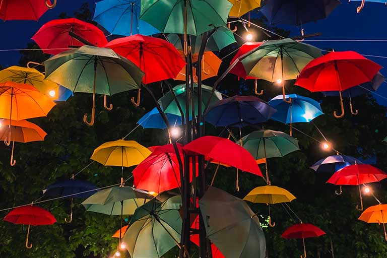 hundreds of floating umbrellas in different colors