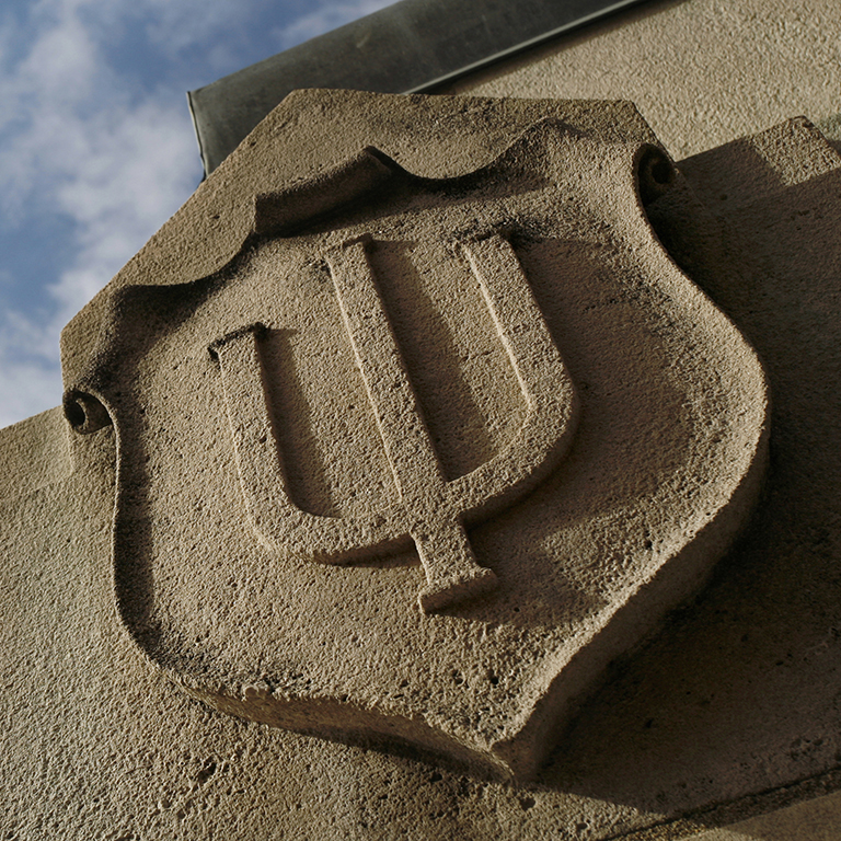 Stone carving of the Indiana University seal