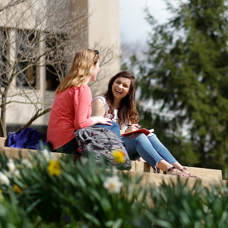 Students talk on the scenic Indiana University Bloomington campus.