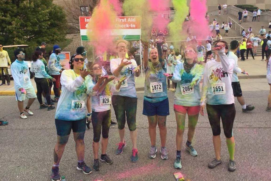 students pose at the color marathon