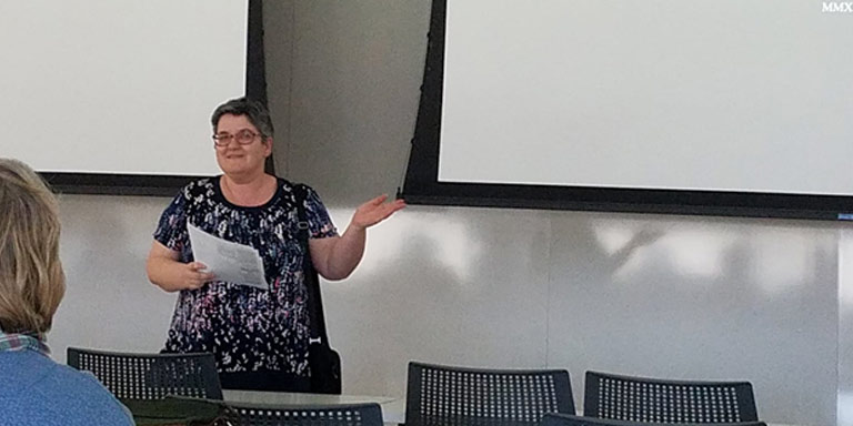 "Senior Lecturer Nikole Langjahr introducing William Selm of the Indiana German Heritage Society speaking about ""Indiana Germans and the Building of Indiana"""