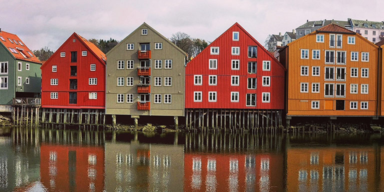 row of colorful houses along the river bank