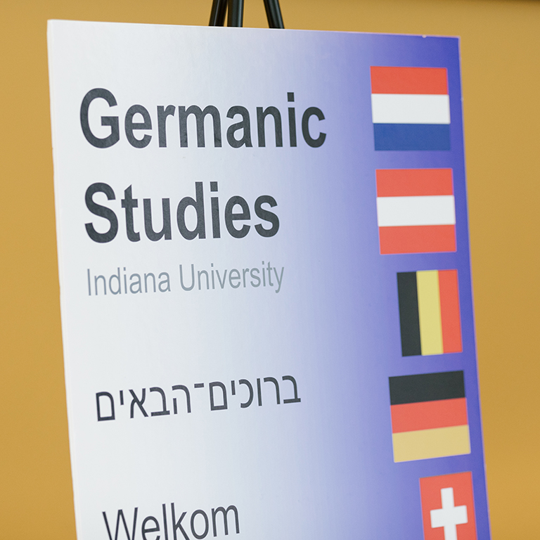 A Germanic Studies sign reading welcome in multiple languages.