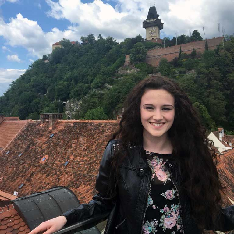 Student in front of historic German buildings